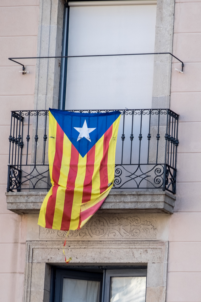 While Barcelona is part of Spain, the whole province would prefer independence . Many homes and businesses show quiet support for their province by flying the flag of Catalonia.