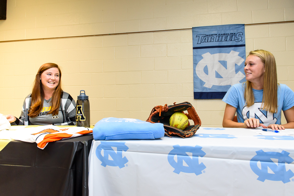 Carson Pace and Hailey Cole share a laugh as they sign on Thursday night at North Davidson High School