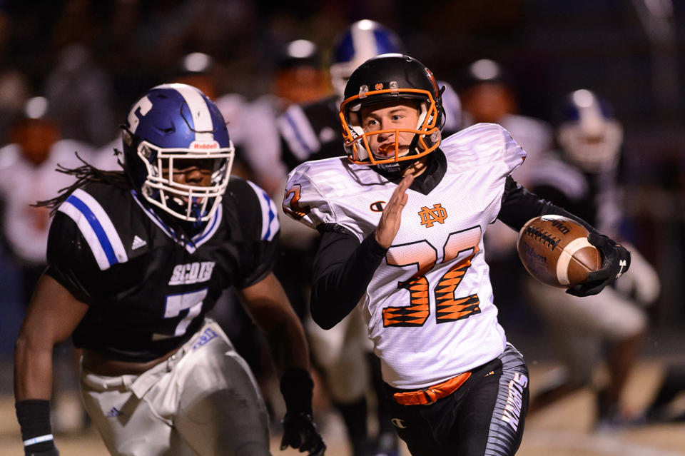 Chris Dunn runs 6 yards on a fake field goal to score for North Davidson