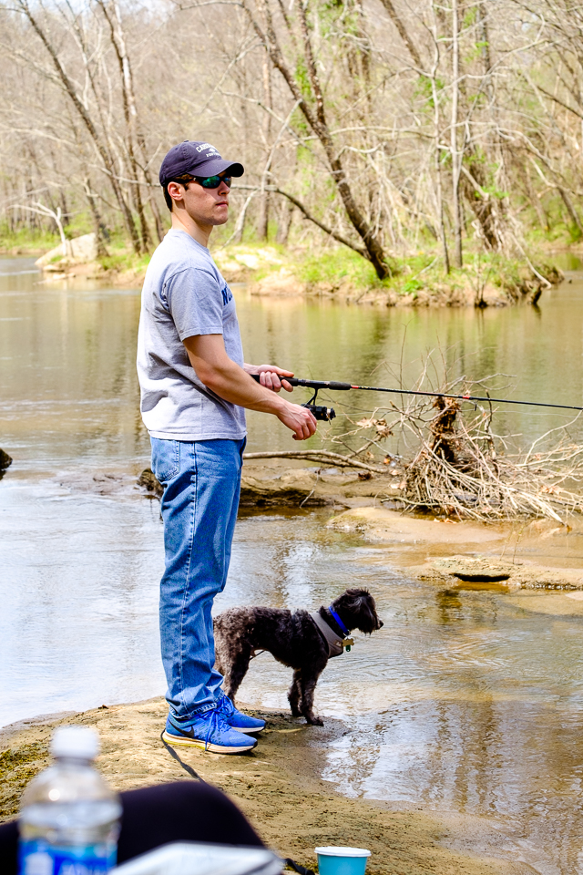 Howie, the fishing dog, helps Graham as he keeps watch for those elusive fish